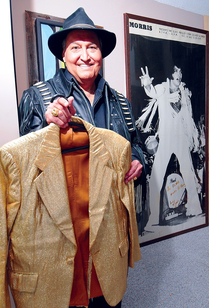 Morris Bates with some of the memorabilia from his globe trotting and Las Vegas days as the world's top Elvis tribute artist. After his long career in music Bates worked for many years with youth at risk in Vancouver and wrote a book about his adventures as Elvis. He is looking forward to coming home to Williams Lake for a visit as the Stampede Honourary Parade Marshall.