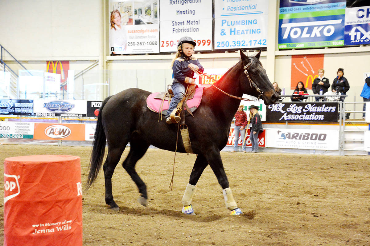Four-and-a-half-year-old Piper Twan rides her horse, Deluxe, in pee wee barrel racing Sunday. Twan was the youngest barrel racer taking part in the festivities during the Williams Lake Indoor Rodeo. (Liz Twan photo)